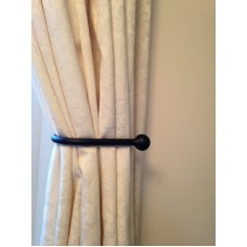 A Pair of Black Wrought Iron Tie Backs with Ball Ends